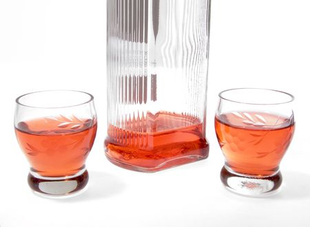Bottle with alcohol and wine-glasses  photo