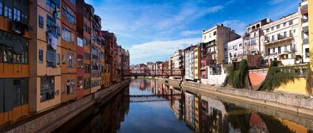 Colorful houses and apartments on the Onyar river in Girona, Catalonia, Spain. Panorama.