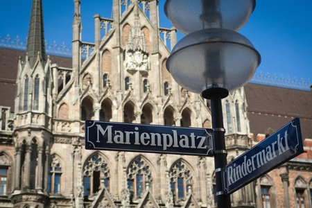 Marienplatz - street and square name in the very center of Munich old town. Blurred Rathaus on the background.