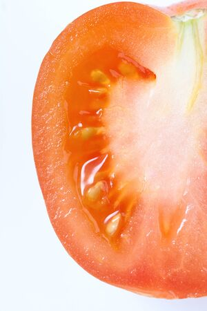 Fresh red tomato. Macro shot. Isolated on white background.
