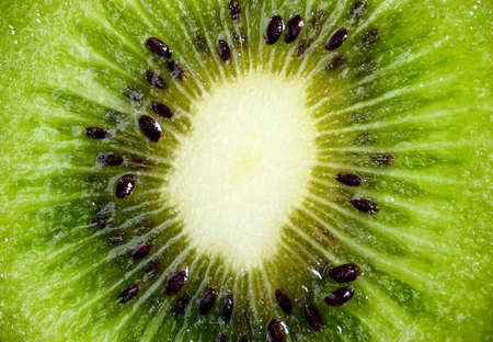 Macro shot of cross-sected kiwi