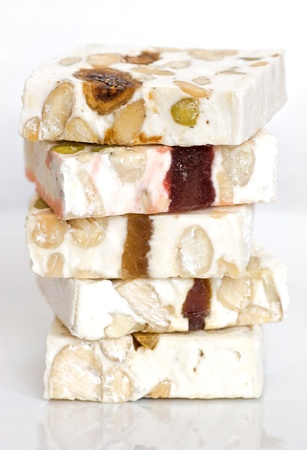 Close-up pieces of sliced delicious nougat from Cassis. Detailed macro. Banco de Imagens