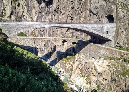 Teufelsbrcke or Devils Bridge is a bridge in the Schllenen Gorge over the Reuss in the Swiss canton of Uri providing access between Airolo and Gschenen via the St. Gotthard Pass Banco de Imagens