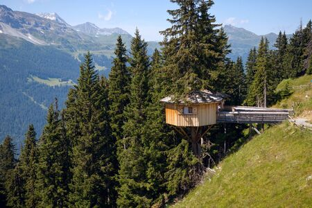 Alpine wooden treehouse in switzerland