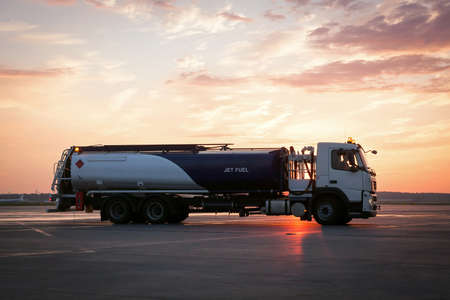 Airport fuel tanker truck on airfield on sunrise Banco de Imagens