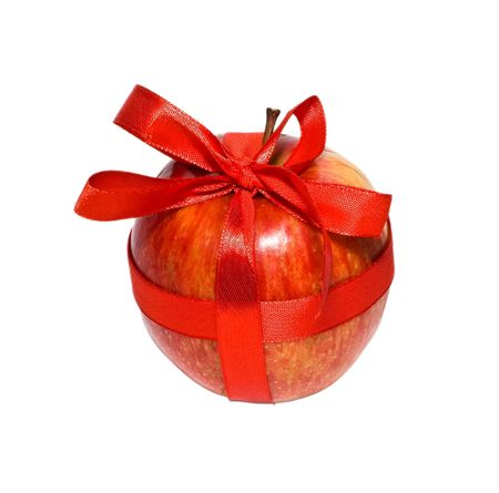 red apple with a gift bow on a white background