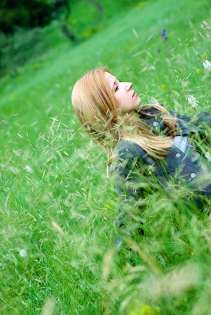 beautiful teen blond girl staying in the meadow Stock Photo