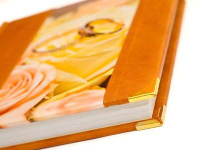 Wedding album with the gold corners on a white background