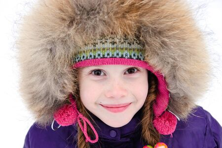 portrait of nice little girl in a winter clothes