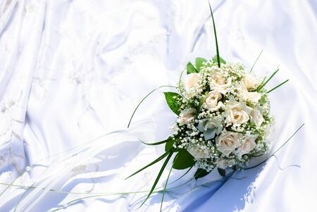 bridal bouquet of white roses on a wedding dress