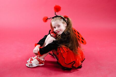 Pretty little girl dressed like a ladybug. Studio shot. Stock Photo
