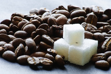 Close-up of roasted coffee beans and sugar. Stock Photo