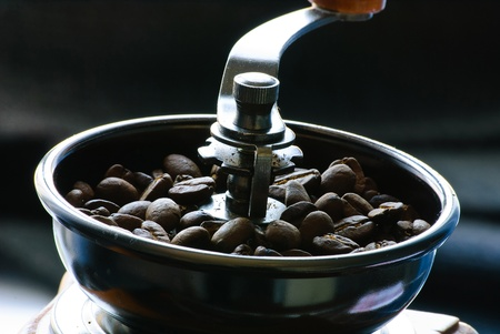 Close-up of roasted coffee beans. Full mill.