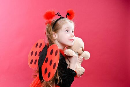Pretty little girl dressed like a ladybug. Studio shot. Stock Photo