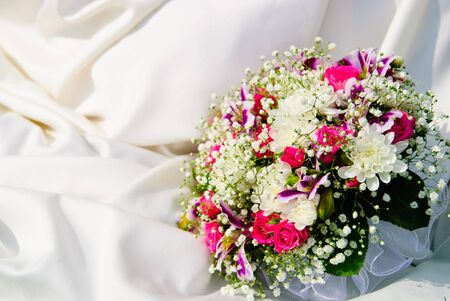 Bridal bouquet of roses on a wedding dress Stock Photo