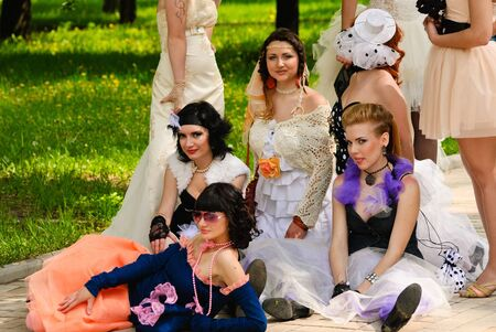 DONETSK, UKRAINE - MAY 15: Annual wedding parade. Bride parade participants in wedding gowns poses during the Bride Parade in Donetsk - May 15, 2011 in Donetsk, Ukraine.