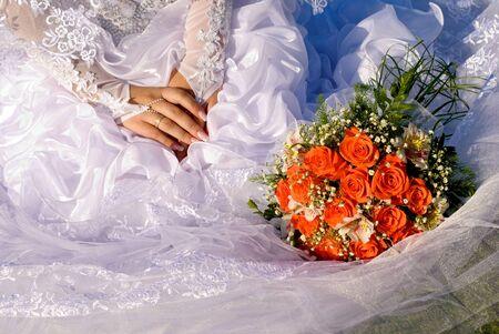 Brautstrauß und den Händen der Braut