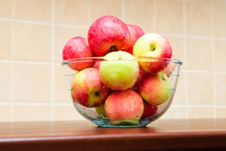 Glass bowl filled with juicy apples Stock Photo