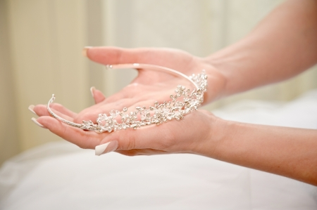 Wedding tiara in bride's hands photo