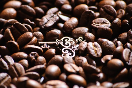 Close-up of roasted coffee beans. And two keys.