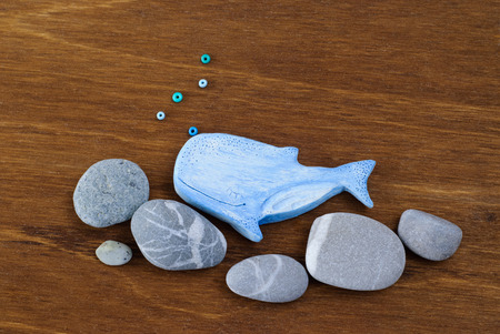 Whale made of clay on a wooden background, Handmade arts and crafts project. Stock Photo