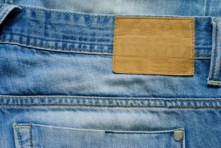 Alte blaue Denimjeans wirh leeres Etikett. Nahaufnahme. Lizenzfreie Bilder