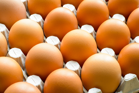 Fresh natural raw chicken eggs. Close up top view. Food background.