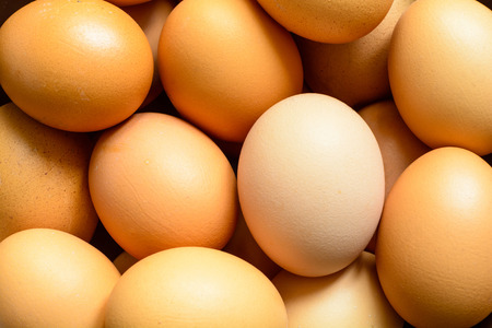 Fresh natural raw hen eggs. Close up top view. Food background.