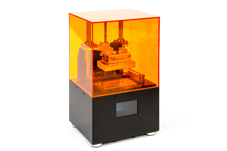 Small home 3D printer on a white background. Studio shot.