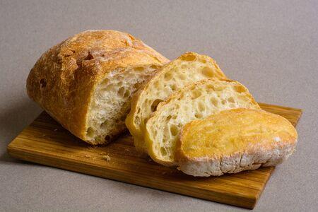 Sliced wheat bread on a wooden board