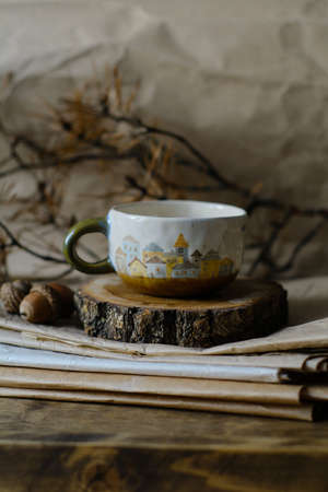 Photography of the authentic handmade ceramic craftware in a cozy home interior. Cup. Stock fotó