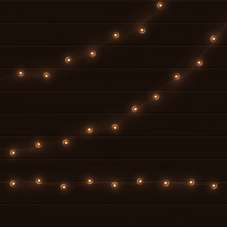 Vector vintage light garland on brown wooden background.