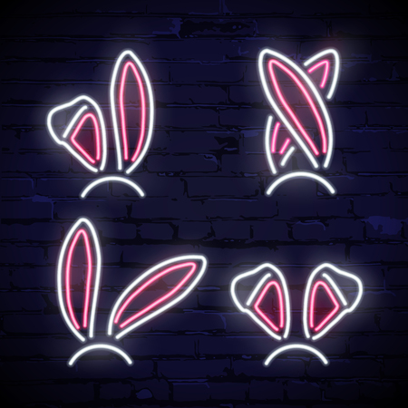 Set of pink and white neon rabbit ears isolated on dark brick background. Vector illustration.