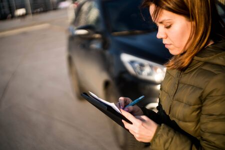 girl fills out protocol car selling accident street