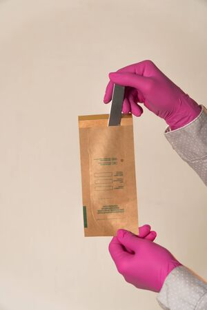 Kraft paper bag to clean spatula close-up vertical