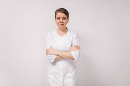 Young female portrait professional doctor , isolated on a light background.Look directly into the camera.