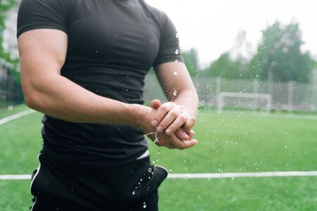 The athlete holds his hand close up. Break your wrist in training. The concept of an accident injury while in a sport