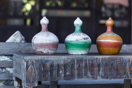 greek pot: Three decorative vases mexican style on wooden vintage table