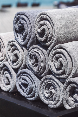 Stack of rolled towels in hotel near beach