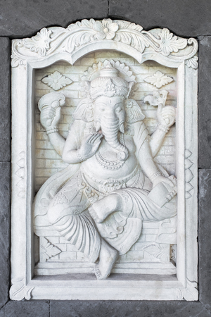 house of god: Stone sculpture of Ganesha god on the house wall in Bali