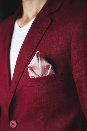 Groom wedding details. Handkerchief in the pocket of red jacket