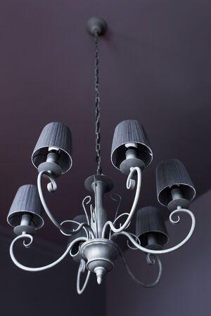 electrolier: VIntage gray chandelier  in dark room