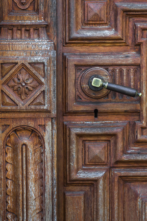 Superbe Stock Photo   Vintage Metal Door Knob On Handmade Wood Carving Door
