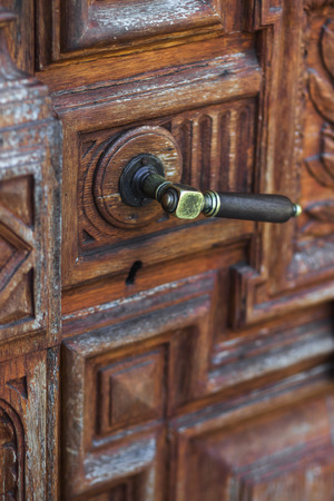 Vintage Metal Door Knob On Handmade Wood Carving Door Stock Photo, Picture  And Royalty Free Image. Image 62411231.