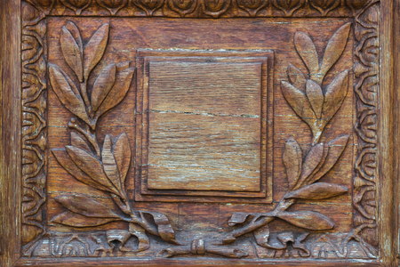 wood carving door: Wood carving door with empty plate with laurel branch ornament Stock Photo