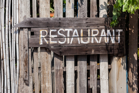 wooden handmade: Wooden handmade sign restaurant on vintage plate