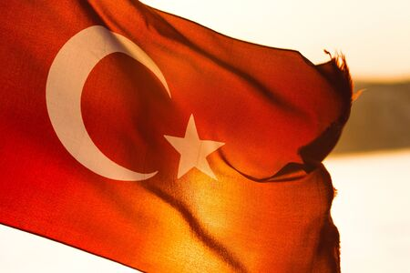Turkish flag fluttering in the sun Stock Photo