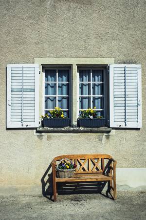 window bench: Window with wooden shutters and a bench with flowers