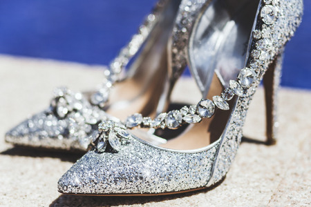Expensive shoes with jewelry shine in the sun 스톡 콘텐츠
