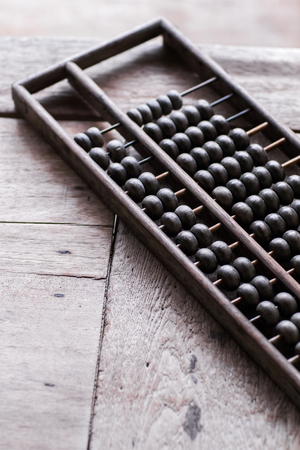 economic revival: Old vintage abacus on wooden table